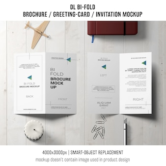 Bi-fold brochure or invitation mockup with still life concept