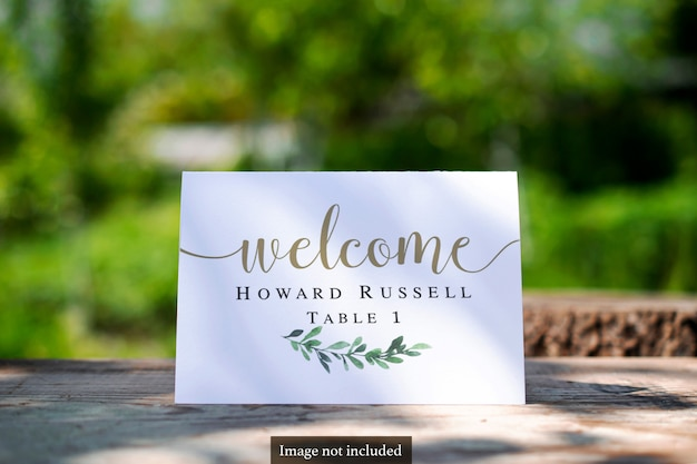 Bi-fold table card on greenery blurred outdoor mock-up