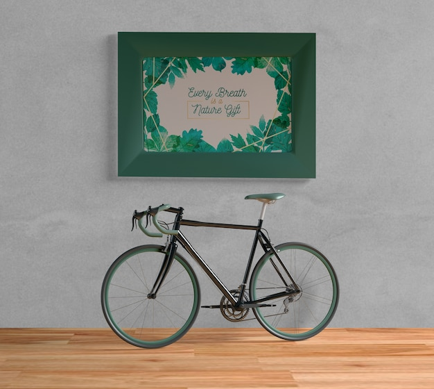 Bicycle with green frame mock-up indoors