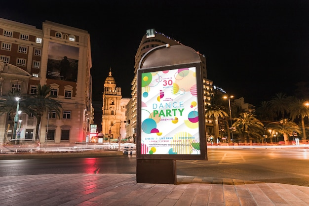 Billboard mockup in city at night
