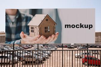 Billboard mockup in front of parking lot