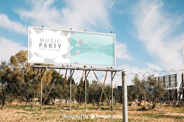 Billboard mockup behind metal fence