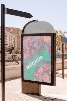 Billboard mockup next to street