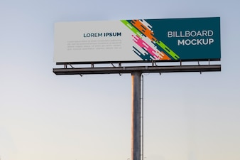 Billboard mockup on sunset sky