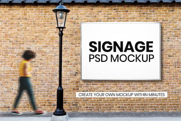 Psd макет рекламного щита на кирпичной стене