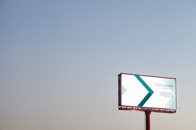 Billboard mockup on sunset sky Free Psd
