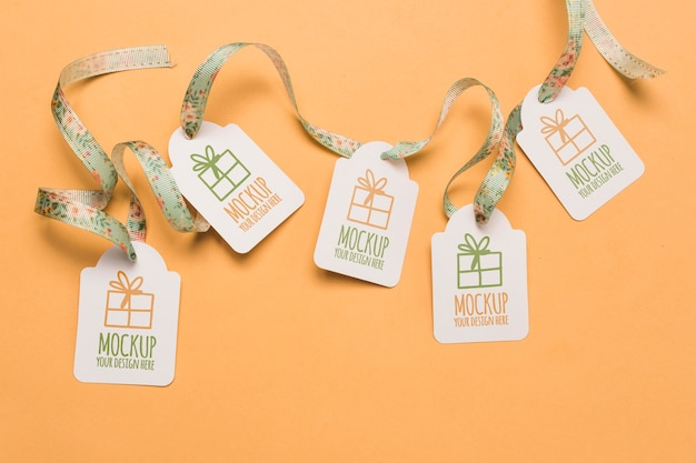Birthday gift tags mock-ups with floral ribbons
