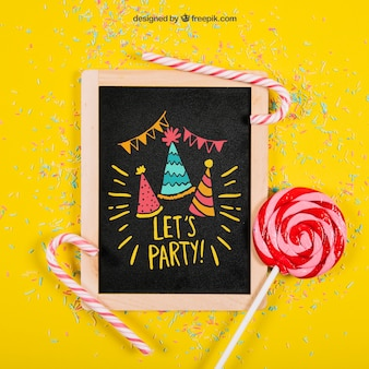 Birthday mockup with slate and lollipop