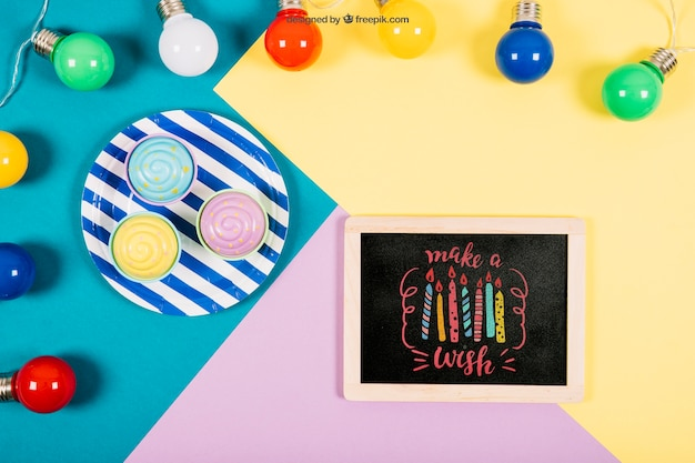 Birthday mockup with slate and colorful bubls