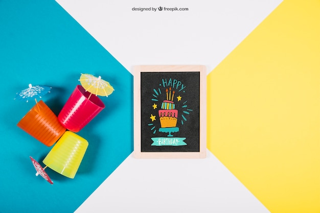 Birthday mockup with slate and plastic cups