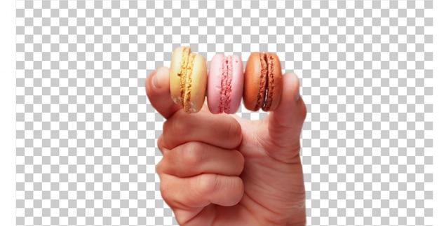 甘いbisquitsを保持している分離された男性の手