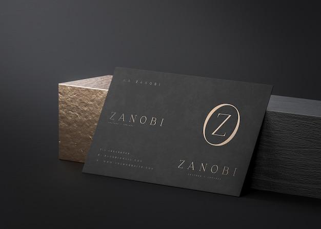 Черно-золотой макет визитки на черном фоне для брендинга 3d рендера
