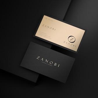 브랜드 정체성 3d 렌더링을위한 검은 색과 금색 현대 명함 모형