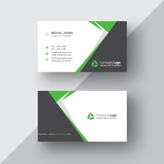 Black and white business card with green details