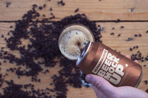 Black beer malt can & hand mockup