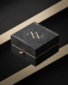 Макет черного ящика для ювелирных изделий или подарочной коробки на черно-золотом фоне 3d-рендеринга
