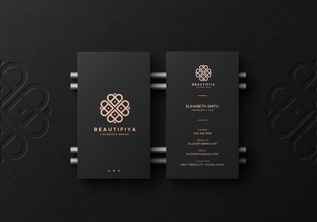 Black business card mockup with deboss logo on background