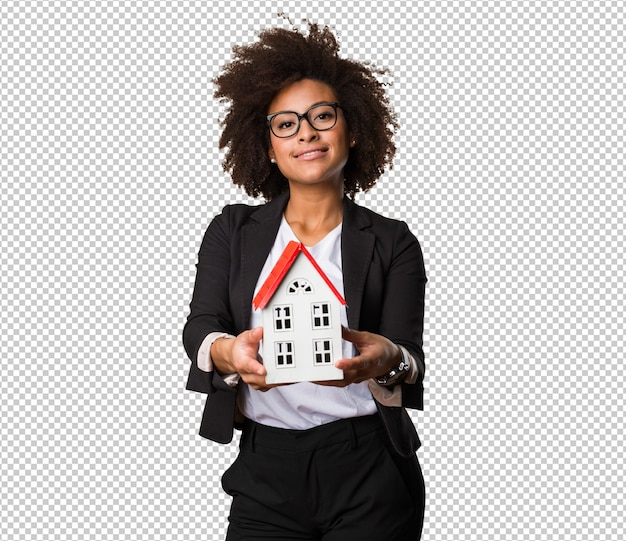 Black businesswoman holding a small house