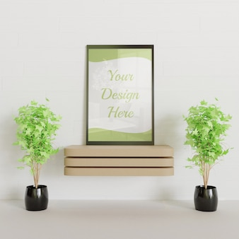 Black frame mockup on the wooden desk with couple decorative plants