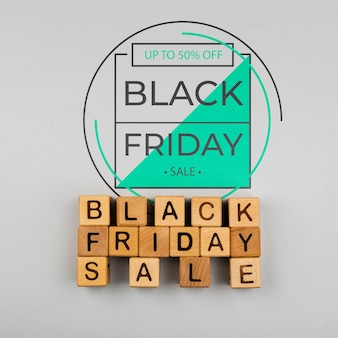 Black friday concept with cubes on plain background