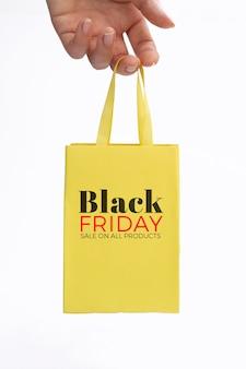 Black friday concept yellow bag mock-up Free Psd