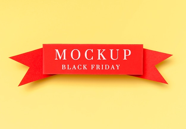 Black friday mock-up red ribbon on yellow background