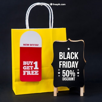 Black friday mockup with bag next to board