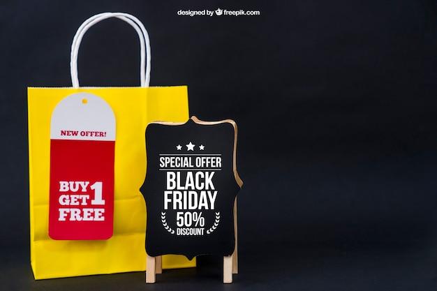 Black friday mockup with board and yellow bag