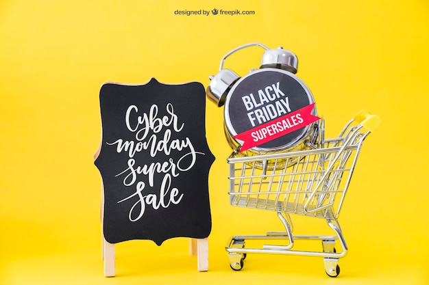 Black friday mockup with cart and alarm Free Psd