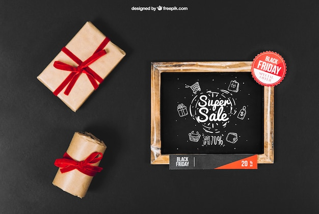 Black friday mockup with slate and gift boxes