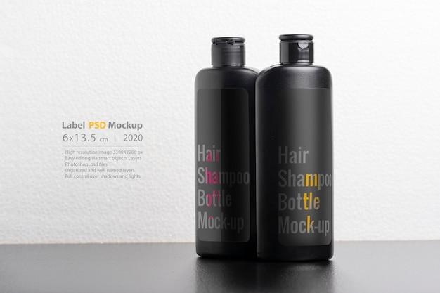 Black hair shampoo bottles mockup