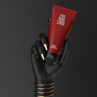 빨간 크림 튜브 모형 3d 일러스트와 함께 검은 손