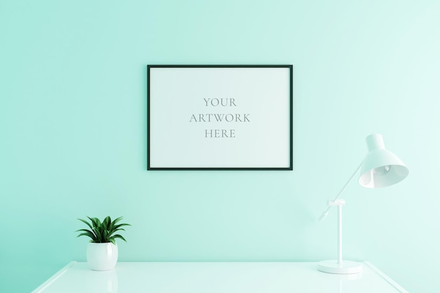 空の白い色の壁の背景にリビングルームのインテリアの作業テーブルに黒の水平ポスターフレームのモックアップ。 3dレンダリング。