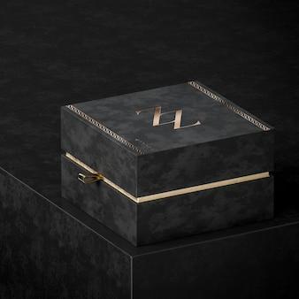 Макет подарочной коробки с черными украшениями для брендинга на черном фоне 3d визуализации
