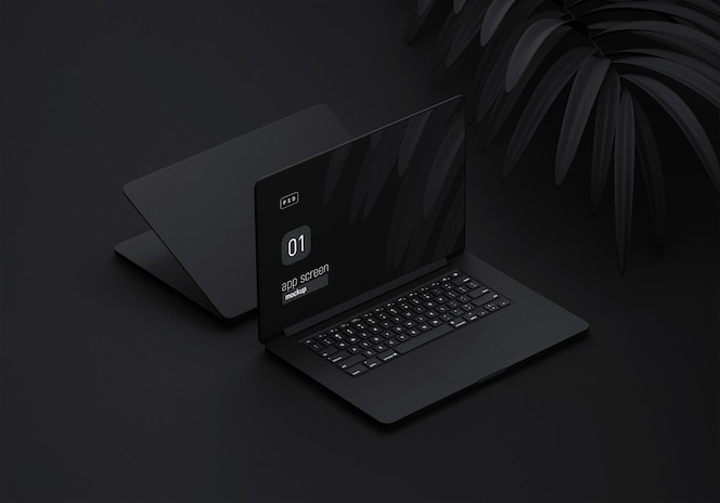 Black laptop mockup with black leaves