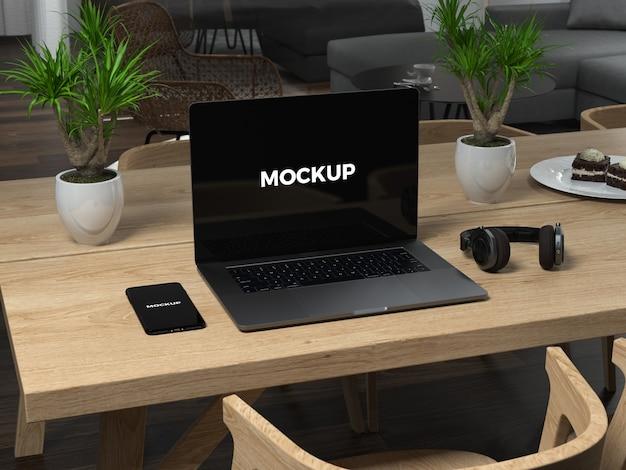 Black laptop on wooden table mock up