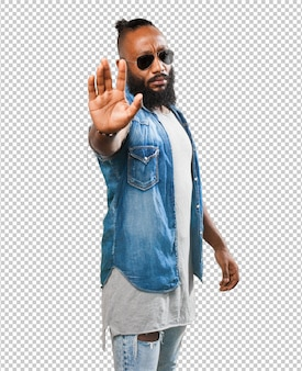 Black man doing a stop gesture