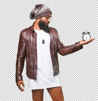 Black man holding an alarm clock
