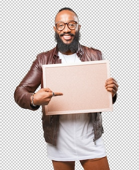 Black man holding a blank cork board