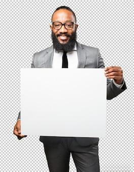 Black man holding a blank white placard