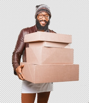 Black man holding boxes