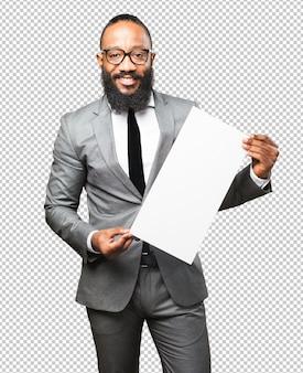 Black man holding a placard