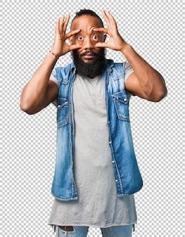 Black man opening eyes on white