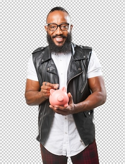 Black man saving with piggy bank