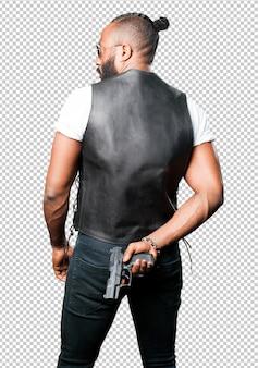 Black man using a pop gun