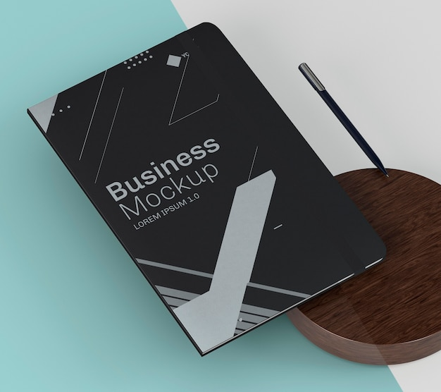 Black notebook and wooden board high view mock-up