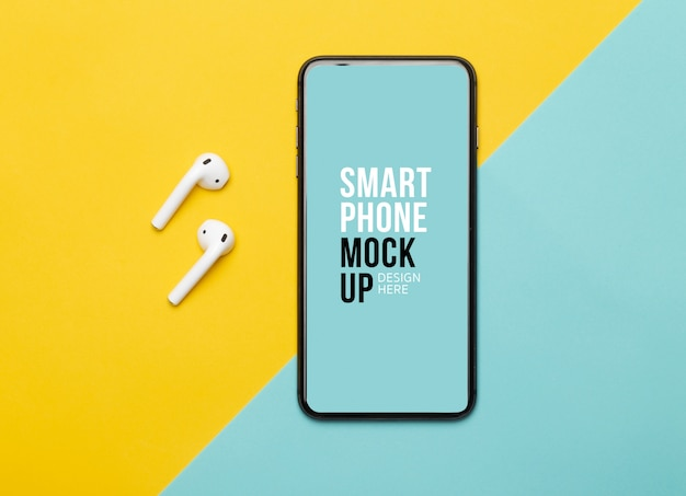 Black smartphone with screen and wireless earphones on yellow and blue background.