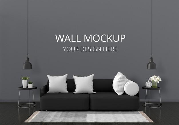 벽 모형이있는 거실의 검은 색 소파