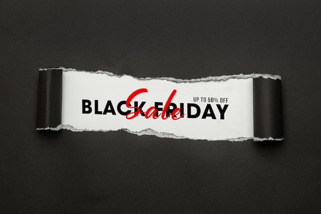 Black torn paper and the text black friday sale mockup