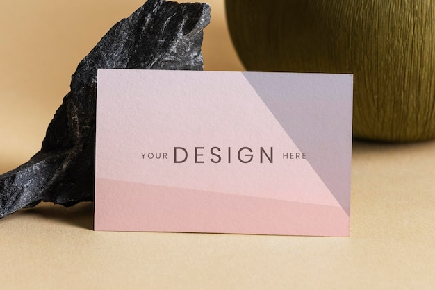 Blank business card on beige surface